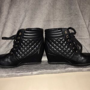 Black faux leather wedged booties